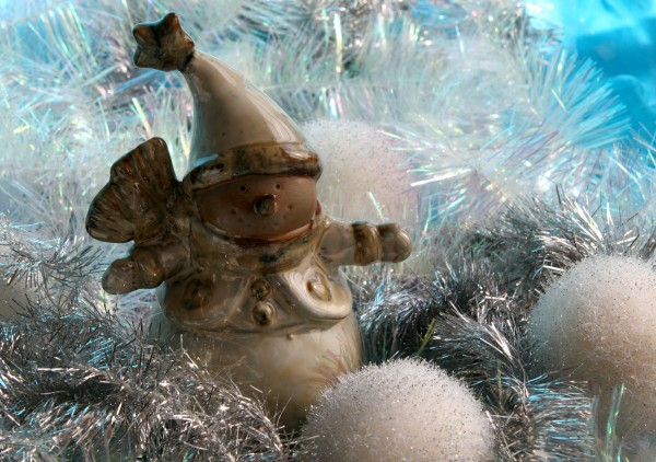 Ceramic snowman with silver tinsel